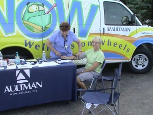 Chelle getting Blood Pressure Check at Cruise In