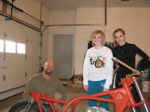 Me and my little girls helping install a engine in my cafe racer bike