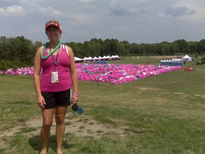 Michelle in front of the Pink tent city her first year the walkers and crew