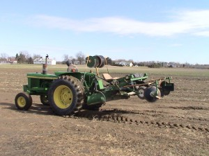 J.D. 2630 with plastic mulch bedder