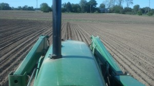 Looking over the hood while planting corn